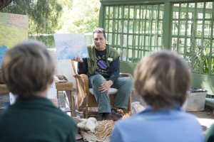 Craig Torres teaches young students in the Rancho Los Alamitos historic gardens in Long Beach. Torres is a member of the Tongva community. Growing up, he says he had little access to information about his heritage, now he spends his days educating children about Southern California's indigenous peoples.